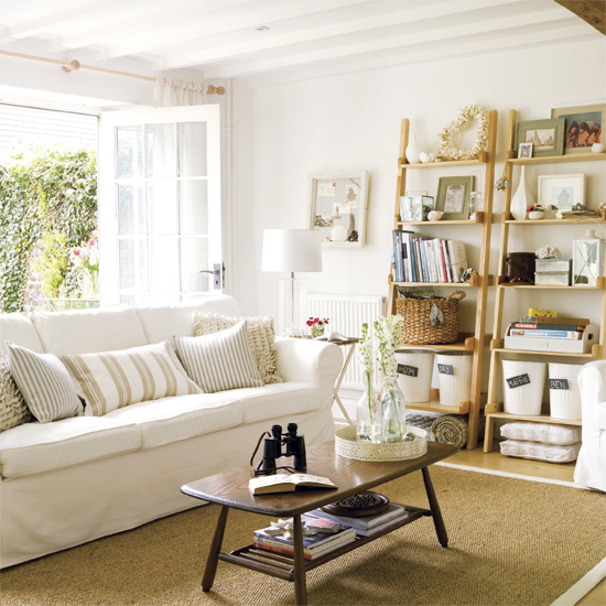 Coastal-living-room-style-with-white-sofa-simple-wooden-table-carpet-and-decorations
