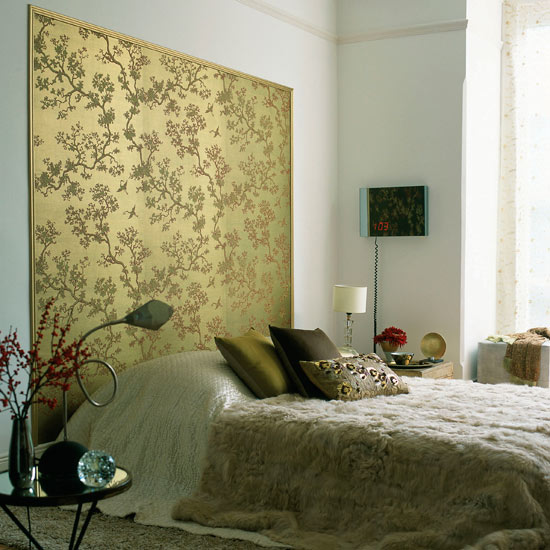 Luxury-bedroom-with-platform-bed-with-golden-tree-wallpaper-for-decoration-