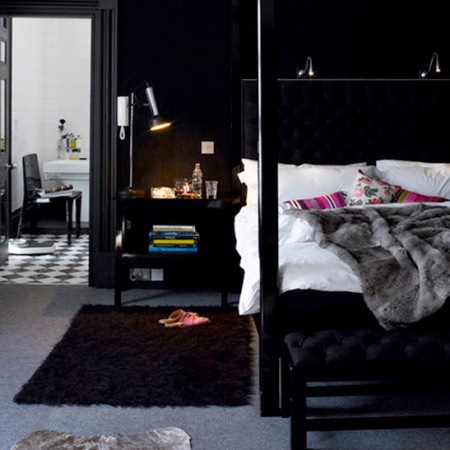 Dark modern bedroom with four poster bed | luxury bedroom ideas | bedroom decorating ideas | modern bedroom ideas | roomenvy