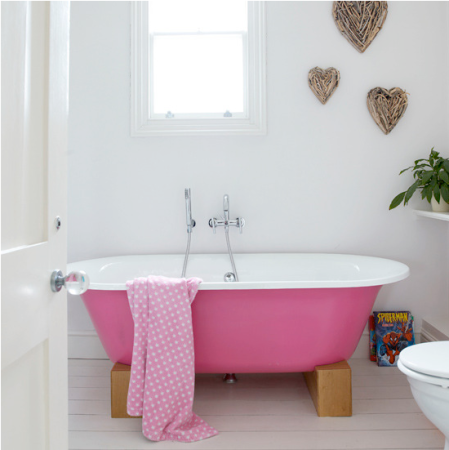 bright pink free standing bath in modern bathroom - modern coloured bathroom suite