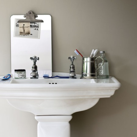 Basin and pedestal with quirky bathroom accessories