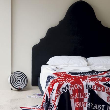 Black bed with Union Jack bedlinen