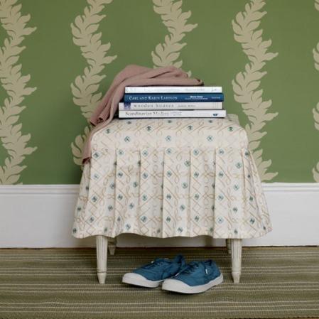Craft books on a decorative footstool